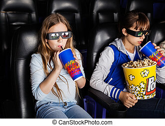 Sisters Watching 3D Movie At Theater