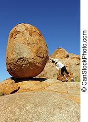 Sisyphus woman pushing boulder - Sexy high heel woman ...