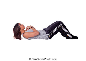 Sit Ups - a beautiful young girl laying on the floor doing ...