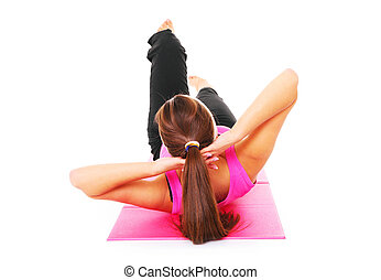 Sit-ups - A picture of a young woman doing sit-ups over ...