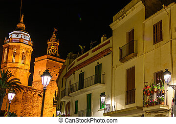 Sitges, Spain - June 10: Illuminated architectural buildings on June 6, 2016 in Sitges, Spain. This coastal city in Catalonia is famous for its Film Festival and Carnival.