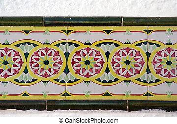 sitges tiles - tiling along a wall in sitges, spain