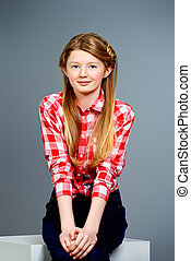Cute smiling teen girl posing at studio. Youth style. Education.
