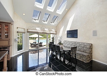 Sitting area with skylights and pool view