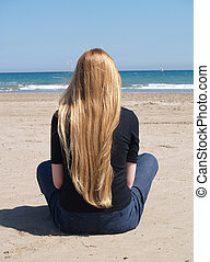 Woman sitting at the beach