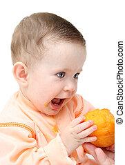 sitting baby eating peach