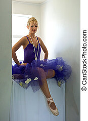 sitting ballerina looking at feet