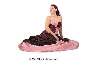 Sitting beautiful woman in luxurious dress
