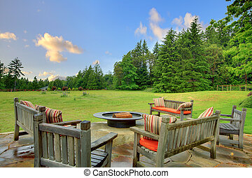 Sitting benches and fire pit and green nature