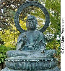 Sitting Bronze Buddha at San Francisco Japanese Garden in...