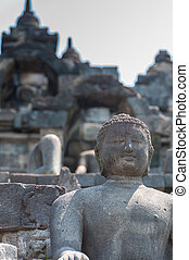 Sitting Buddha in stone at Borobudur, Indonesia