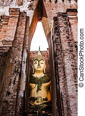 Sitting Buddha in Wat Si Chum temple, Sukhothai