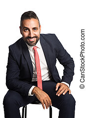 Sitting businessman smiling