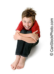 Sitting child in jeans and t-shirt