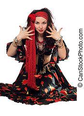 Sitting expressive gypsy woman