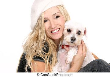 Sitting girl cuddling a dog - A sitting female hugging a ...