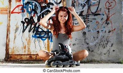 sitting girl with roller skates
