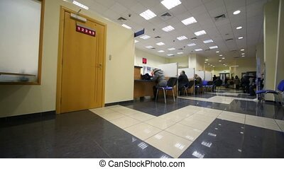 sitting in chairs clients during consultation in bank,...