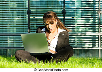 Sitting in the lawn with Laptop
