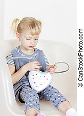 sitting little girl with a handbag