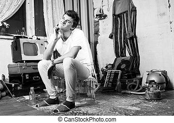 Sitting Man Pricking his Pimple at Abandoned Room