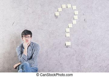 Sitting man question mark
