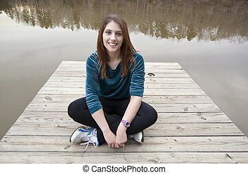 Sitting on a wooden dock