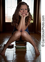 Sitting on stack of books