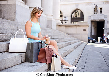 sitting on steps in the city