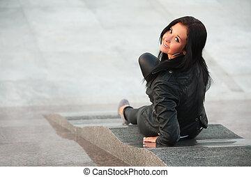 Sitting on the sidewalk