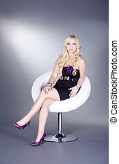 sitting pretty blond woman
