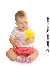 Sitting small baby with yellow flower