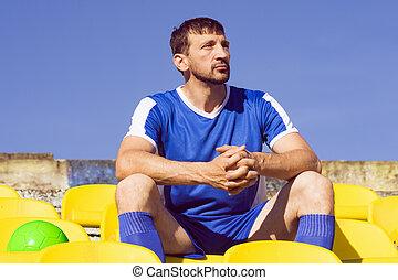 sitting soccer player