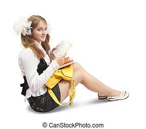 Sitting teen girl reading book