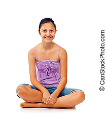 Sitting teenage girl while rejoices with arms up. - Sitting...