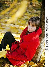 Sitting Under Autumn Tree