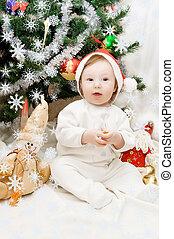Sitting under Christmas tree