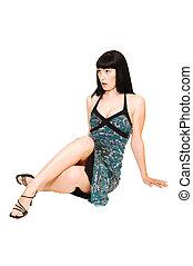 Sitting woman in dress.