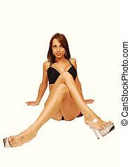 Sitting woman in lingerie.