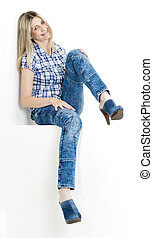 sitting woman wearing jeans and denim clogs