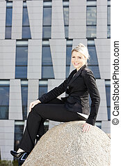 sitting young businesswoman