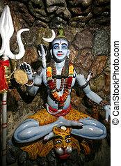 siva - Siva statue in hanuman temple cave in delhi, india