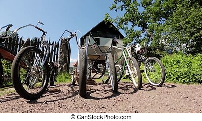 Six bicycles in front of open gates and big mansion in...