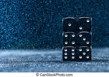 Six black different dice on a blue background. The concept of gambling. Cubes from one to six.
