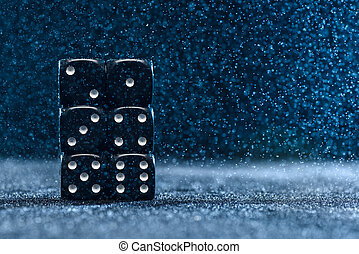 Six black different dice on a blue background. The concept...