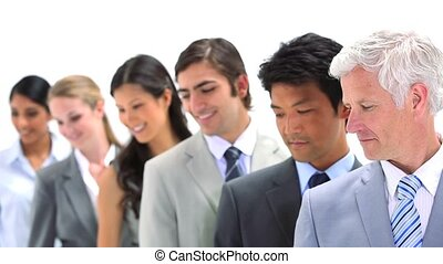 Six business people standing in a line against a white...