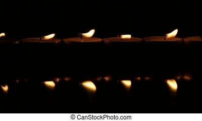 Six candle light. Close up - Reflection of candles on the...