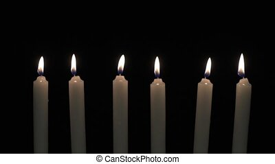 Six candles in a row - Six candles are placed in a row with...
