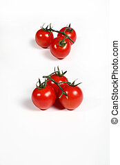 six cherry tomatoes on white