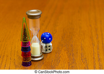 Six colored pawns and two dice isolated on a wooden background